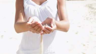Close up under view detail of a girl's hands holding sand — Stock Video