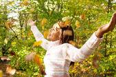 Young teenager walking through an autumn park — Stock Photo