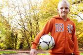 Boy play with football ball — Stock Photo