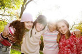 Four young and diverse friends in park — Stock Photo