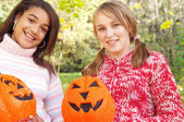 Two girls halloween pumpkins — Stock Photo