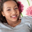 Mixed race teenage girl smiling — Stock Photo