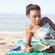 Woman reading  on  beach — Stock Photo #42517623