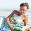 Woman reading  on  beach — Stock Photo #42518271