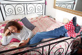 Teenage girl reading a book — Stock Photo