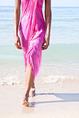 Black woman on a beach — Stock Photo