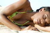 Woman relaxing on beach — Stock Photo