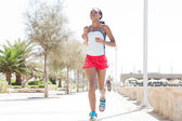 Woman running and exercising — Stock Photo