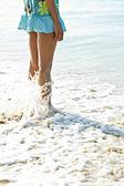 Woman standing on beach — Stock Photo