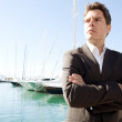 Businessman standing by a luxury yachts — Stock Photo #42523333