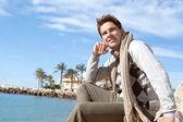 Smart man on a beach — Stock Photo