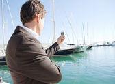Businessman hand holding a smart phone — Stock Photo
