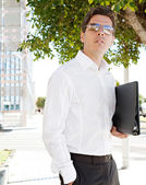 Attractive businessman wearing sunglasses — Stock Photo