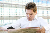 Business man reading  newspaper — Stock Photo