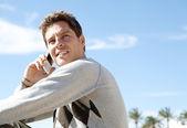 Man having a conversation on his smart phone — Stock Photo