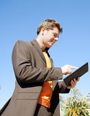 Businessman using a digital tablet — Stock Photo