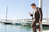 Businessman using his smart phone — Stock Photo