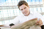 Business man reading a financial newspaper — Stock Photo