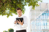 Successful businessman using a digital tablet — Stock Photo