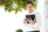 Successful businessman using a digital tablet — Stock Photo