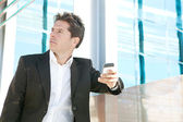 Professional business man holding a smart phone — Stock Photo