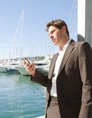 Businessman using his smart phone — Stock Photo