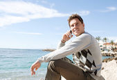 Man sitting down on the shore — Stock Photo
