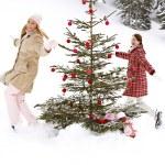 Girls running around christmas tree — Stock Photo #42539693