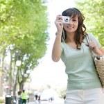 Woman using photographic camera — Stock Photo #42533947