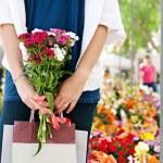 Woman in flowers market — Stock Photo #42534025