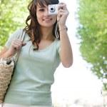 Woman using photographic camera — Stock Photo #42534067