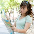 Woman holding a map — Stock Photo