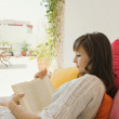 Woman reading a book — Stock Photo #42534423