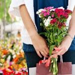Woman in flowers market — Stock Photo #42534425