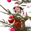 Woman decorating a christmas tree — Stock Photo #42539579