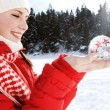 Woman holding a snow globe — Stock Photo #42539627