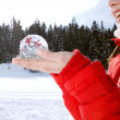 Woman holding a snow globe — Stock Photo