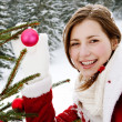 Woman decorating  christmas tree — Stock Photo #42539705