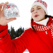 Woman holding a snow globe — Stock Photo #42539875