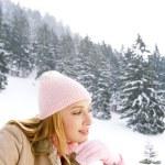 Woman on the snow mountains — Stock Photo