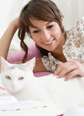 Student woman stroking her cat — Stock Photo