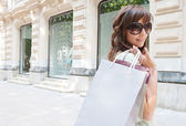 Woman  down  shopping avenue — Stock Photo