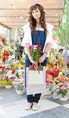 Woman  in  flowers marke — Stock Photo