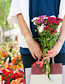 Woman  in flowers market — Stock Photo