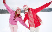 Two girls playing games and having fun in in winter — Stok fotoğraf