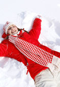 Woman laying down on the snow — Foto Stock