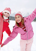Two girls playing games and having fun in in winter — Stockfoto