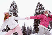 Girls  in snow mountains — Stock Photo
