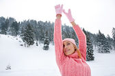 Woman  in the snowed mountains — Stock Photo