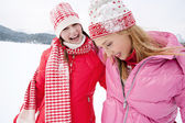 Two young women in winter outdoors — Stock fotografie
